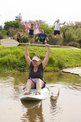 Bianca Du Plessis, Kate Karow, Jared Coetzee and Peter Martin (background) support Abi Cloete as she approaches the finish of her first Dusi Canoe Marathon. Photo: Roxanne Daniels