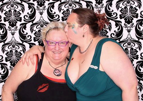 My friend Claire giving me a kiss at the Party.