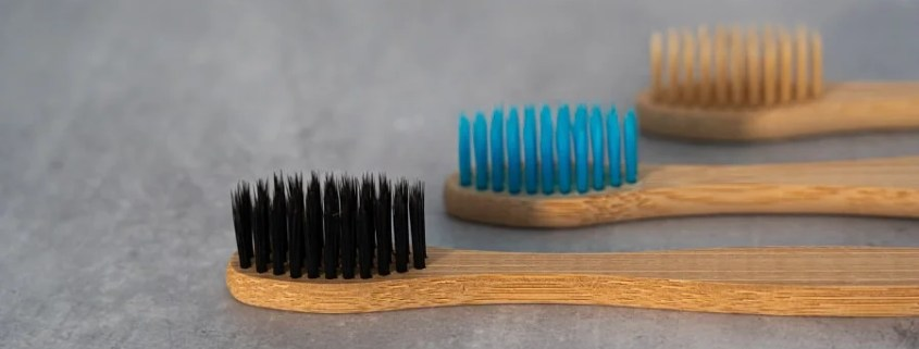 Three wooden toothbrushes