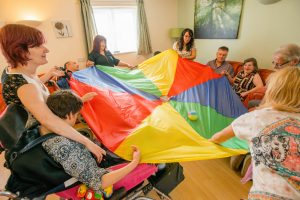 Several people playing the parachute game