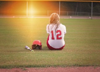 Teenager on softball pitch