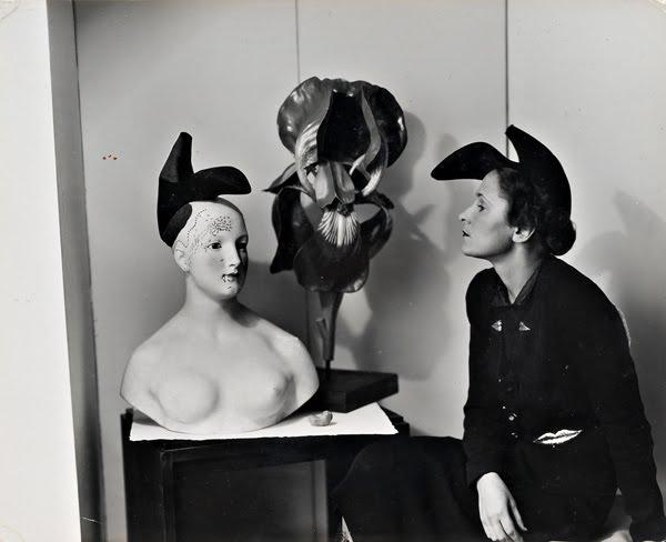 Photo of daring Italian designer Elsa Schiaparelli modeling her Shoe Hat