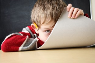 child with ADHD struggling with homework
