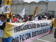 Members of the CUT labor federation in Colombia march for peace in Colombia.