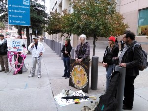 Mohyeddin Abdulazziz of the American-Arab Anti-Discrimination Committee addresses the rally