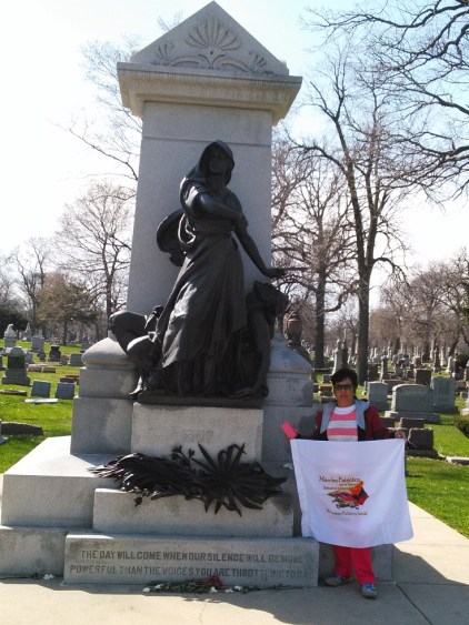 Nidia Quintero, of Colombia's Fensuagro, shows internationalist solidarity at the grave of the Haymarket martyrs.