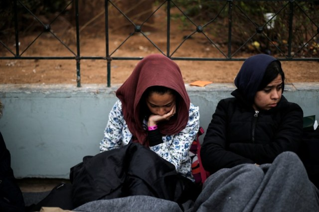 Stranded Afghan migrants rest on Victoria square in Athens, Greece, February 24, 2016. REUTERS/Alkis Konstantinidis