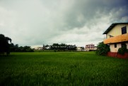 Rain clouds, fields, house.