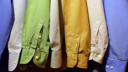 close up of clothes hanging on fabric