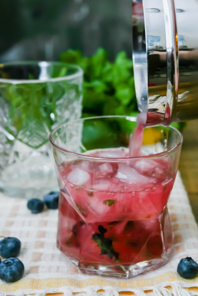 fresh blueberries, cilantro, citrus juice, and honey simple syrup give a killer twist to the class margarita. blueberry cilantro margaritas are easy, gorgeous, and delicious! blueberry cilantro margaritas | a flavor journal small batch cocktail recipe