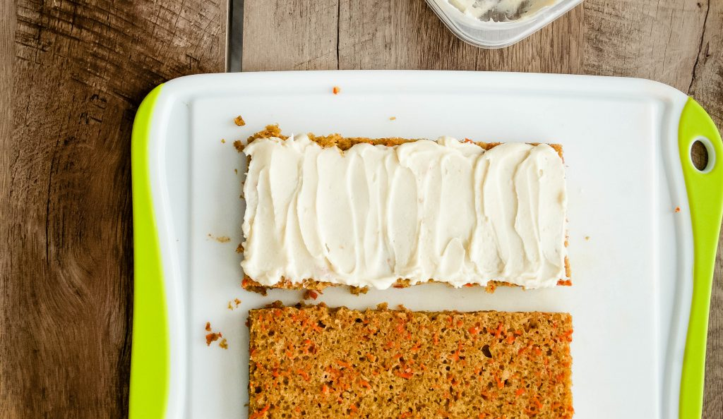 super moist, decadent, and incredible carrot cake is cut into squares for a bite size dessert to please a crowd. carrot cake squares | a flavor journal food blog