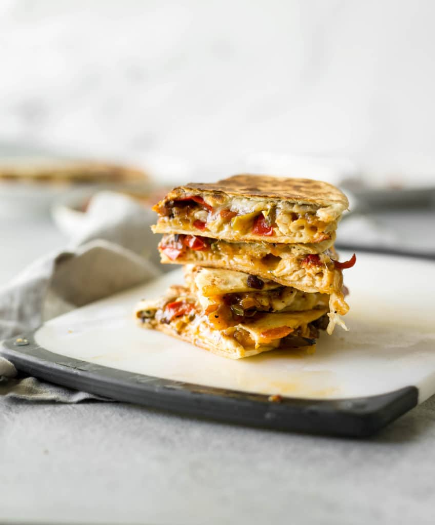 chicken quesadillas packed with veggies, chicken, and cheese. an awesome dinner idea for any night of the week!