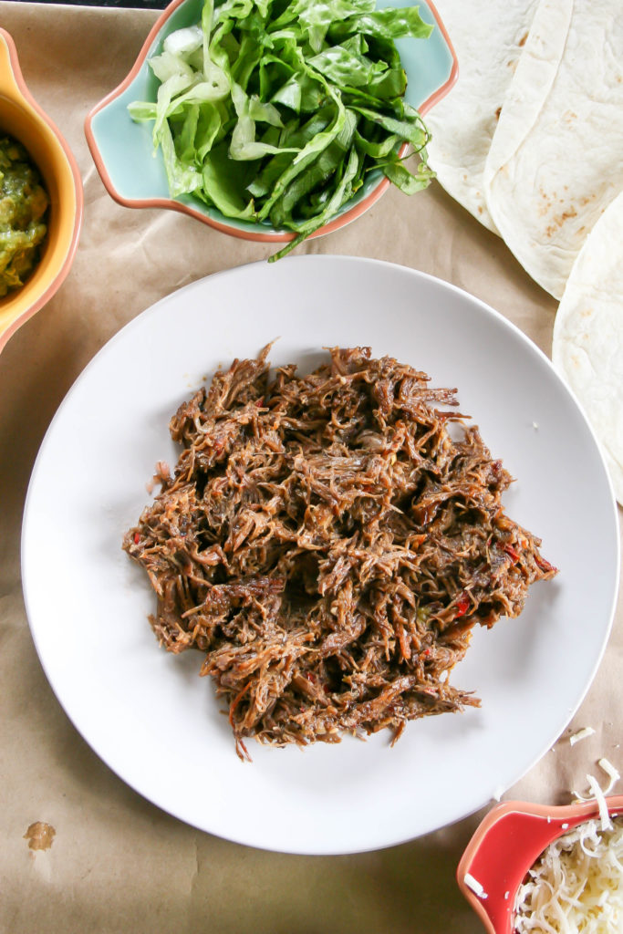 slow cooker spicy shredded beef | a flavor journal : Chuck roast, chipotles, spices, and veggies simmer for eight hours in your slow cooker to make the BEST spicy shredded beef for dinner!