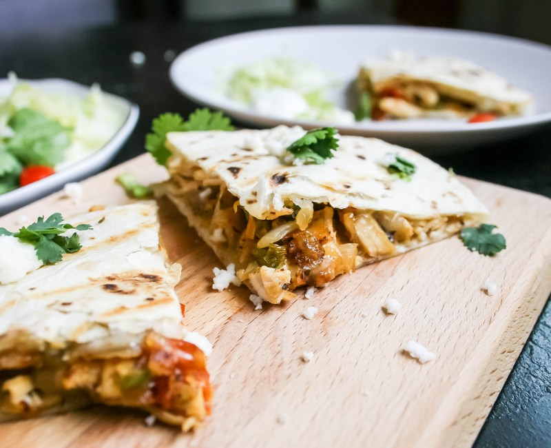 easy, quick chicken quesadillas with TONS of flavor and a little heat! perfect for a weeknight dinner, or an excuse to have a margarita.