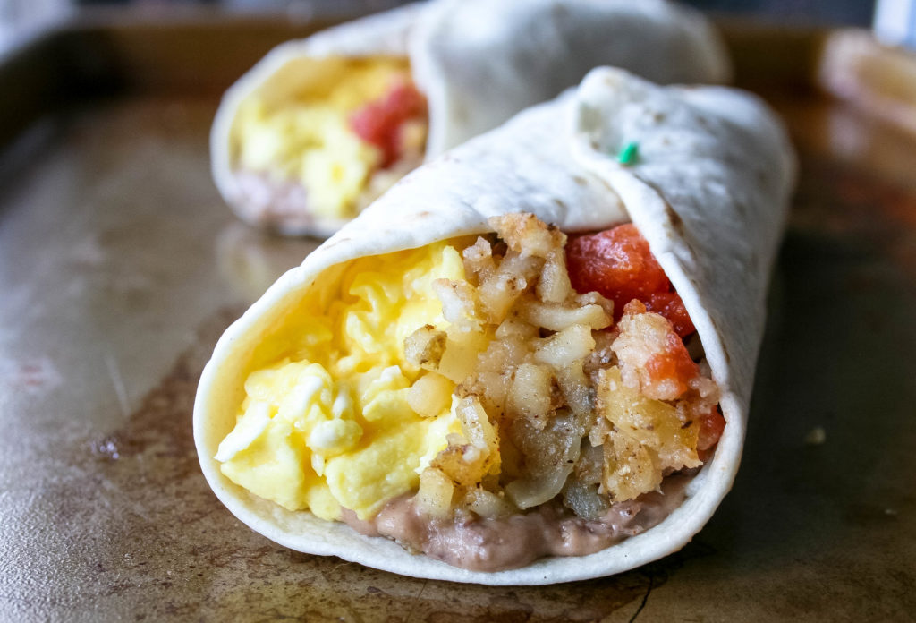 creamy black beans, soft and fluffy eggs, and crispy hashbrowns make the ULTIMATE breakfast burrito. top it with your favorite salsa, and you're golden. | a flavor journal small batch recipe