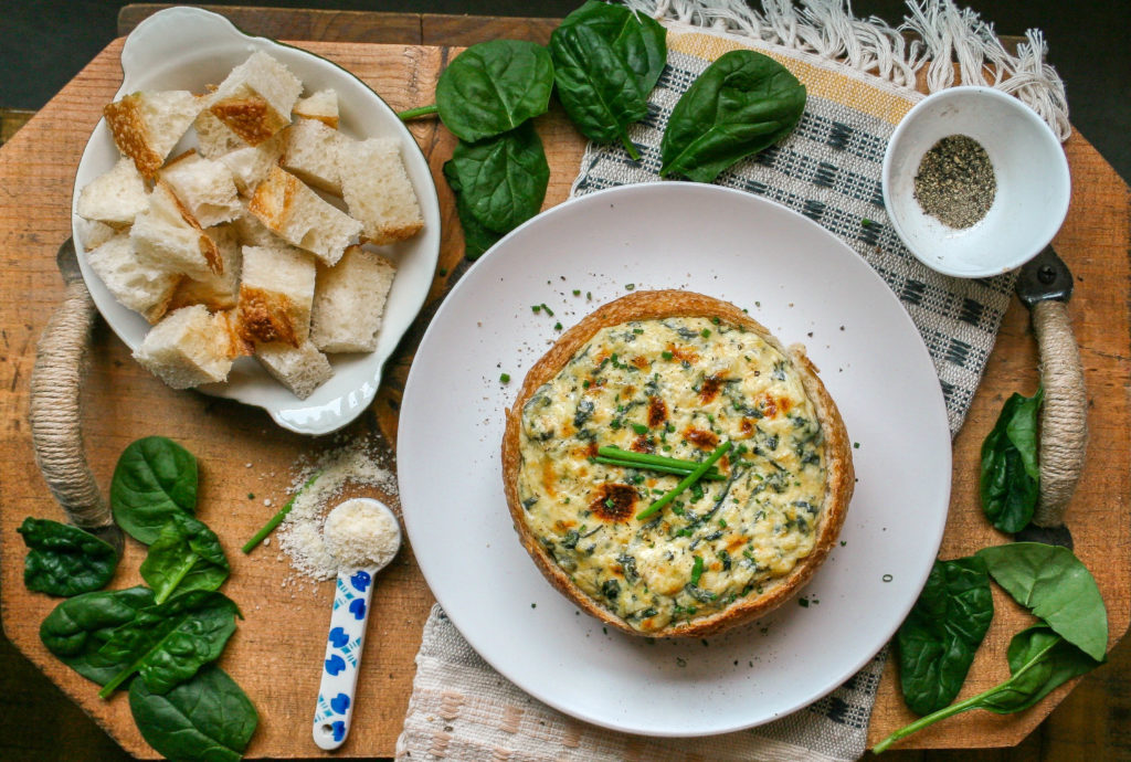 spinach + artichoke dip is a perfect appetizer to kick off any party. take my gourmet approach by broiling it in a bread bowl, for a beautiful presentation to impress your guests! | a flavor journal food blog