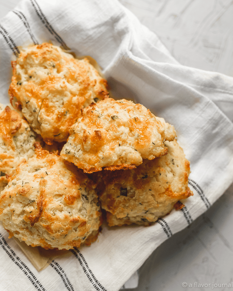 A warm basket of six cheddar chive drop biscuits