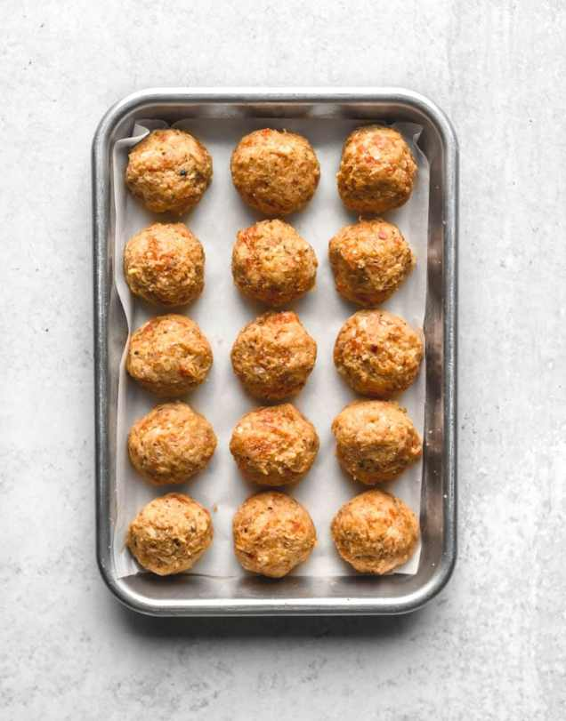 small batch baked meatballs mixed with ricotta cheese : fifteen meatballs with spicy sausage, ricotta cheese, and tons of flavor.