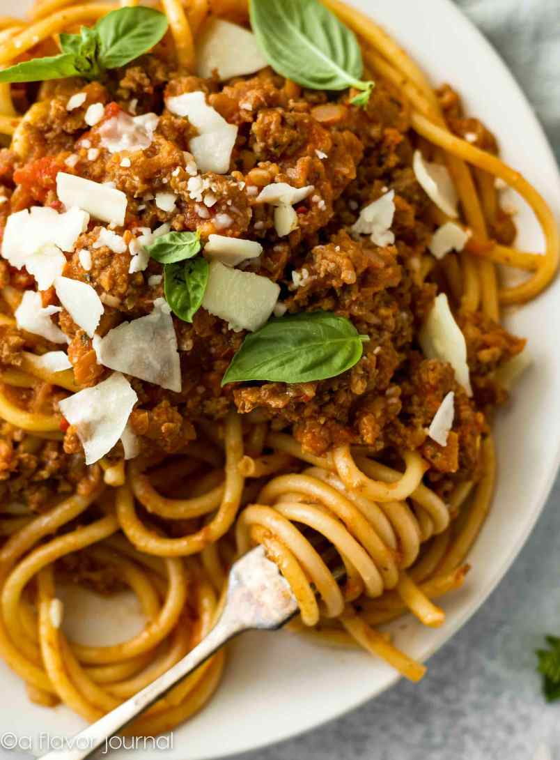 Bolognese Sauce with bucatini noodles for a cozy home-cooked meal idea.