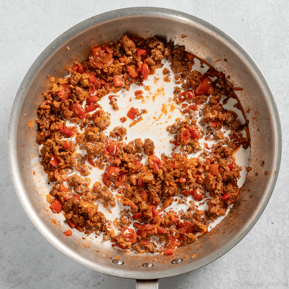Process shot of cooking chorizo and tomato pasta