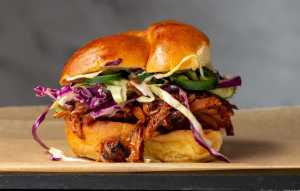 Shredded BBQ Beef on a roll with coleslaw