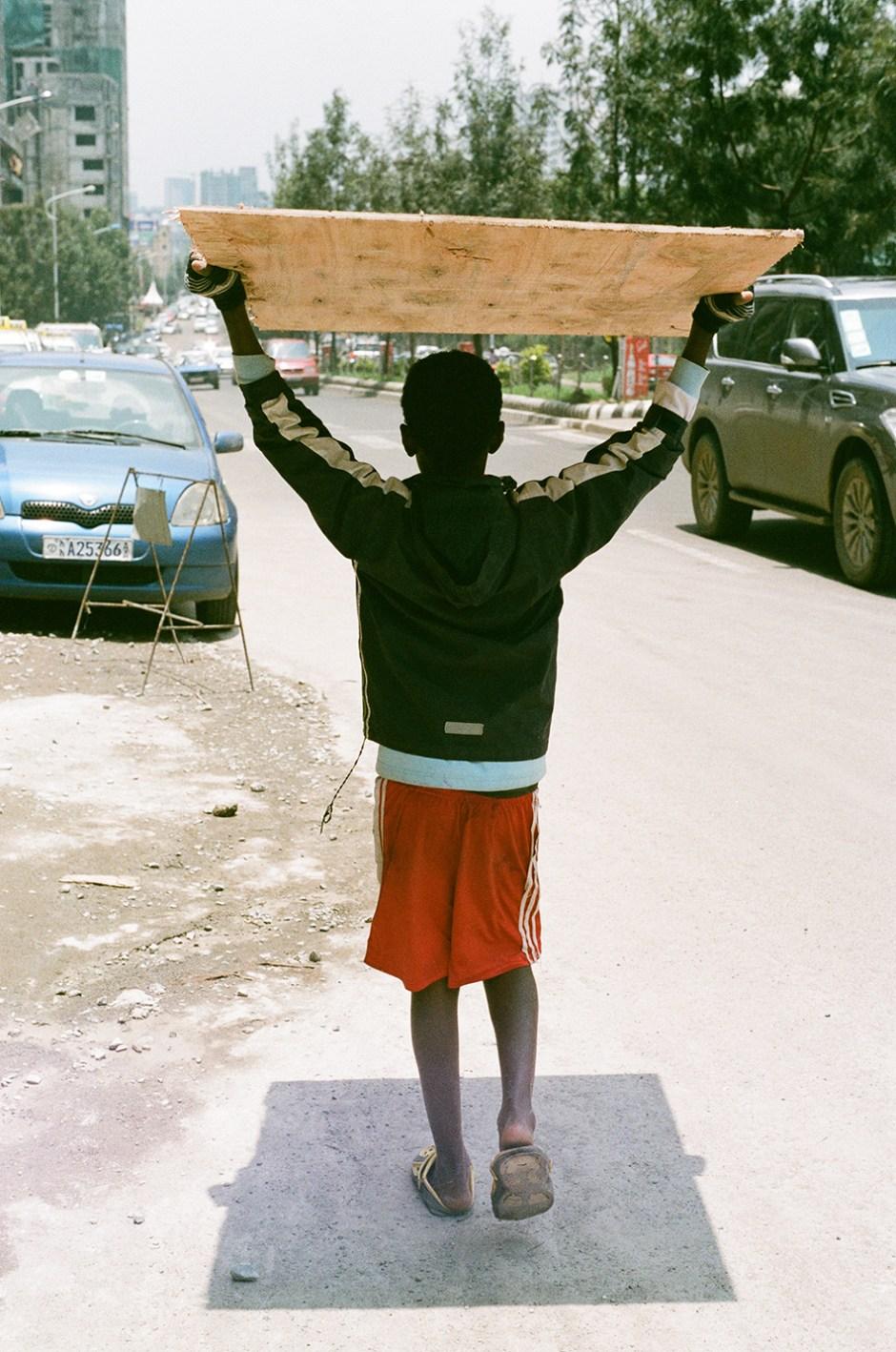 20 - Boy under wood in Addis