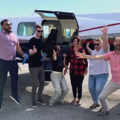 Dr Ian Shulman and a group making funny poses after his flying anxiety course.