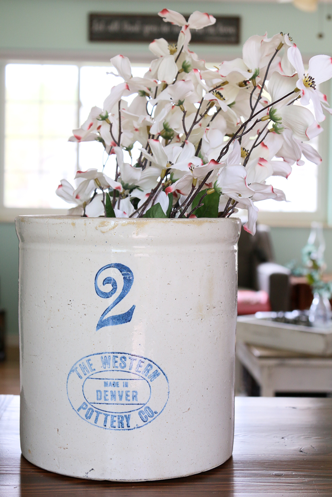 Buying enough flowers to fill a bucket or crock can be surprisingly expensive. Let me show you how to fill a vessel with flowers without breaking the bank!