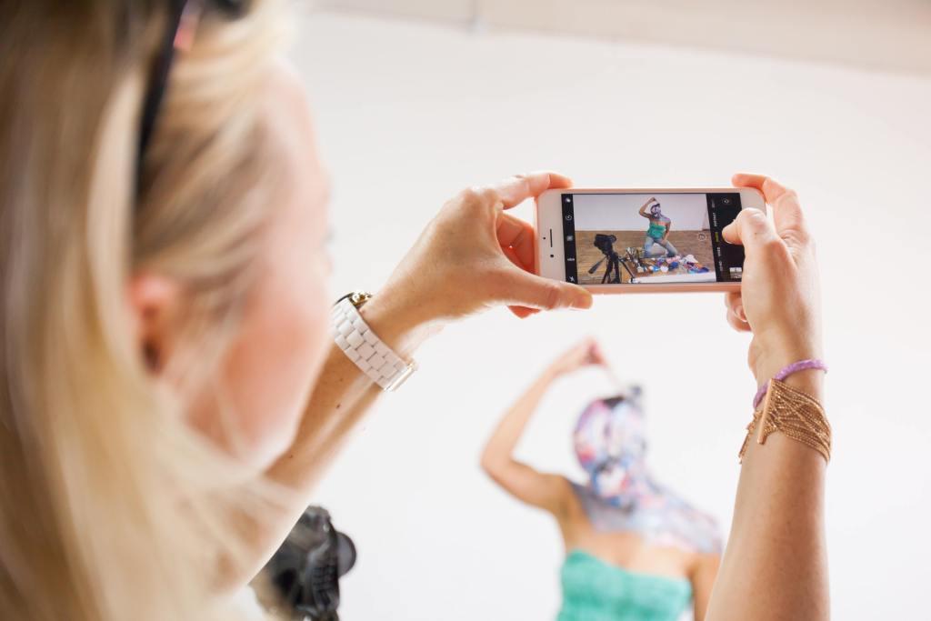 Phone taking photo of artist Lorraine Van Wyk in Action