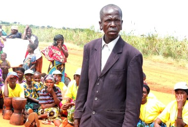 A farmer listens keenly