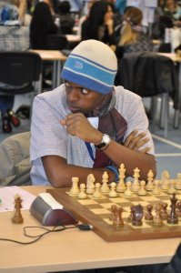 Alain preparing himself for a tough battle against his Sierra Leonean opponent at the Chess Olympiad 2010