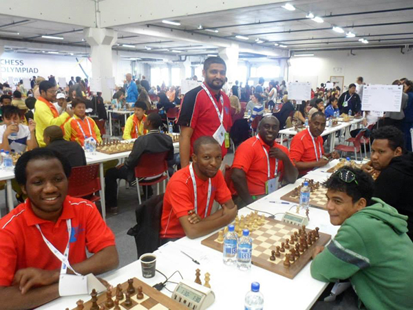Hemed (second from left) playing in the 2014 Chess Olympiad with fellow team members