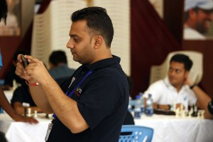 Ravi Shah, SNVM's chess coordinator records the event on his phone / Photo by Paras Gudka