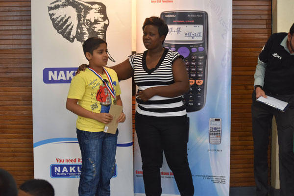 Sunil Subramaniam (Under 12) receiving his prize from chess parent Rodah Olisa / Photo by Paras Gudka