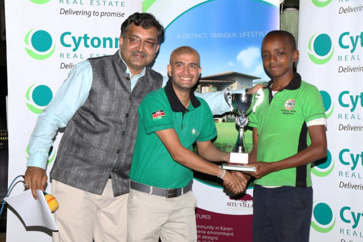Jeff Gichuki receiving his prize for First Place in the Under 14 Section / Photo by Allan Rongoey