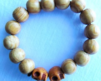 wooden bracelet shaped brown skull