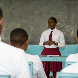 Kisa Scholar presents in front of class thanks to sponsor   AfricAid   Denver, CO
