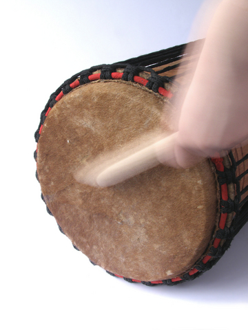 Music Playing African kenkeni drum with stick
