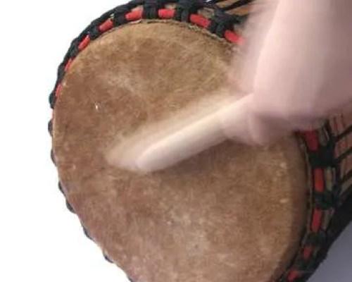 Music Playing African kenkeni drum with stick