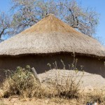 Just off the big cities south africa there is landscape hut in the old style of the african tribes-c-Temis