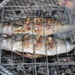 Barbecue grill with fresh stuffed fish