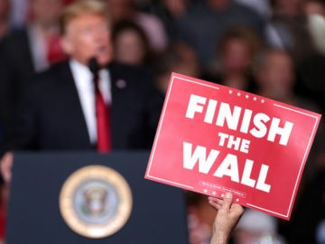 "Photo of sign saying ""Finish the Wall"" at a Trump rally in this article on border security by African American Conservatives. Photo credit: Gage Skidmore"
