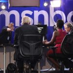 Photo of a panel in front of the MSNBC logo
