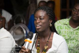 Me asking a question at Ayesha H. Attah's reading. Photo Credit: J.K Photography