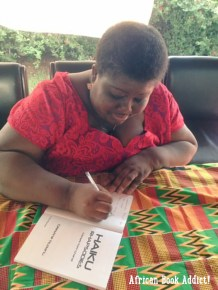 Author - Celestine, of book blog -'Reading Pleasure' (https://readinpleasure.wordpress.com/) signing my copy of her African Haiku collection, at her book launch!