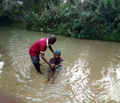 Idongesit Uduak Thompson being baptized by Mojima Etokudo