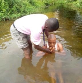 Mojima Etokudo baptizing Udoisong into Christ at Ikot Osute