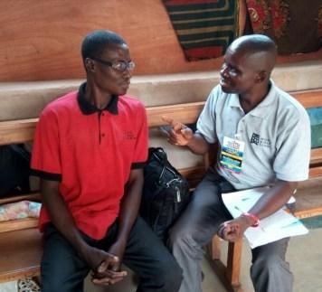 Mojima preaching to the denominational church founder Umoke