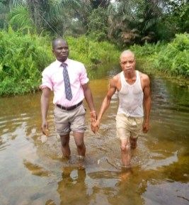 Mojima & Udoisong stepping out of the water after Baptism