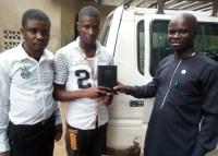 Ofonbuk Udom received Bible from Mojima Etokudo